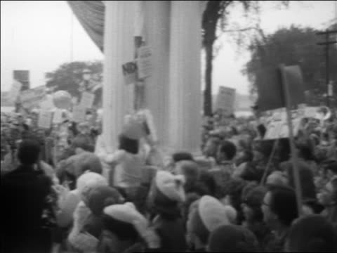 pan crowd holding posters to richard pat nixon on stage at political rally / michigan - richard nixon stock-videos und b-roll-filmmaterial