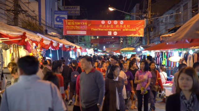 crowd in chiang mai night walking street, chinese new year - chiang mai province stock videos & royalty-free footage