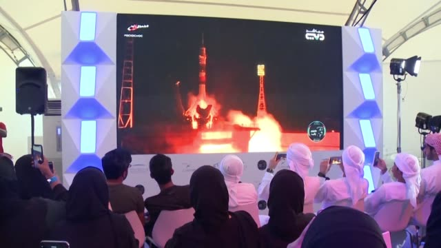 crowd in dubai erupt in cheers and applause as the first astronaut from the united arab emirates launched towards the international space station... - astronaut stock videos & royalty-free footage
