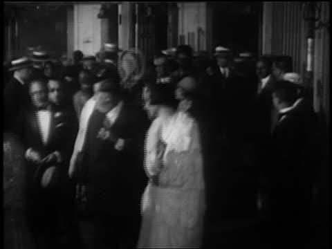 B/W 1927 crowd in formalwear at opening night of 'Glorifying the American Girl' in NYC / newsreel