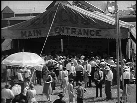 B/W 1946 crowd in front of circus tent entrance