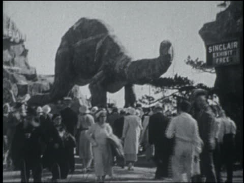 b/w 1933 crowd in front of dinosaur exhibit at chicago world's fair - chicago world's fair stock videos and b-roll footage