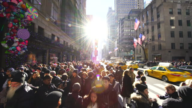 crowd in front of saks fifth avenue window displays, who watches the christmas decoration of winter holiday 2016. many tourist and shoppers make congestion around midtown on fifth avenue new york. - fifth avenue stock videos & royalty-free footage