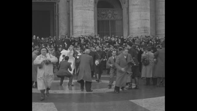 ms crowd in front of st peter's / mussolini and wife walking with other wedding attendees / vs son vittorio and wife orsola buvoli leave church... - benito mussolini stock-videos und b-roll-filmmaterial