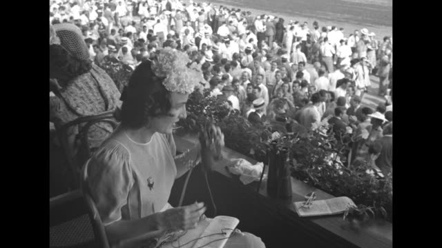 crowd in grandstands at saratoga race course / two shots mrs plunkett stewart and friend / alfred gwynne vanderbilt ii / manuela hudson vanderbilt... - eastern usa stock videos and b-roll footage