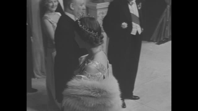ws crowd in lobby of royal opera house for ballet performance / montage princess elizabeth enters in tiara and evening wear / queen elizabeth arrives... - 1950 stock videos & royalty-free footage