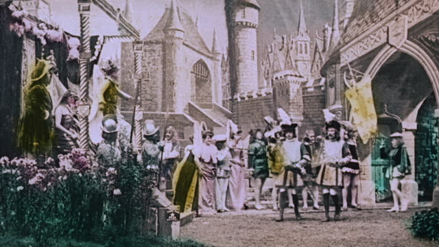 1903 ws crowd in medieval town celebrating return of princess in the film, le royaume des fées (the kingdom of fairies) by georges melies - 1903 stock-videos und b-roll-filmmaterial