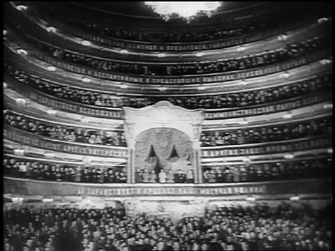 crowd in opera house standing + applauding for stalin's speech / russia - オペラ座点の映像素材/bロール