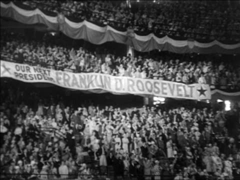 b/w 1932 crowd in stadium at 1932 democratic national convention with fdr banner - 1932 stock-videos und b-roll-filmmaterial