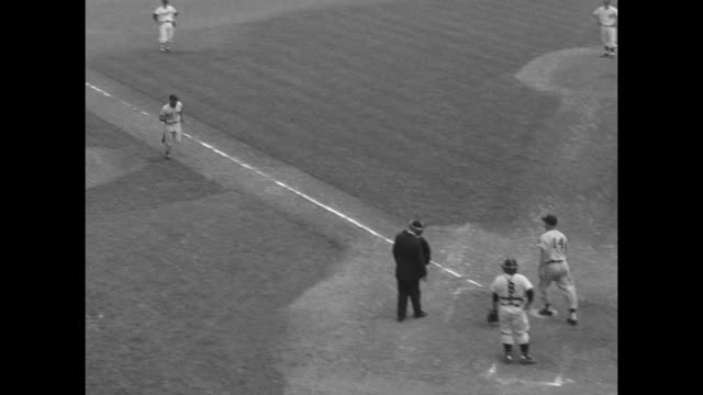 crowd in stands at 1956 major league baseball all star game / chicago white sox pitcher billy pierce on mound / johnny temple, cincinnati redlegs, at... - baseball pitcher stock videos & royalty-free footage
