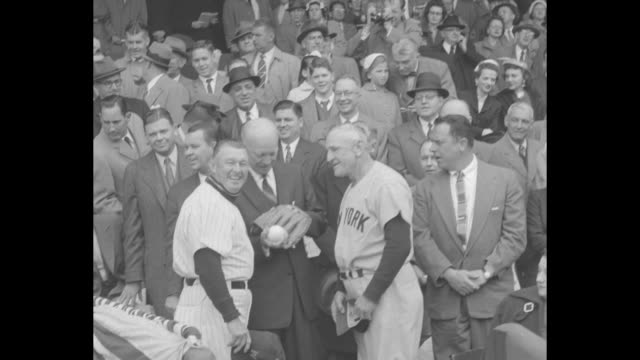 crowd in stands at griffith stadium for washington senators' home opener / president dwight d. eisenhower enters stands / president in stands /... - ニューヨーク・ヤンキース点の映像素材/bロール