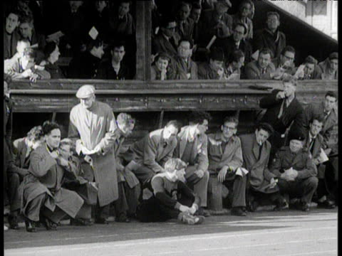 Crowd in stands look on anticipating Roger Bannister running world record sub four minute mile Iffley Road Oxford 6 May 1954