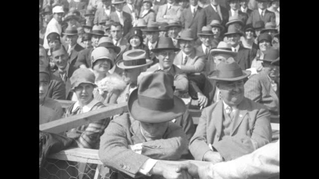 crowd in stands / pittsburgh manager donie bush on left and ny manager miller huggins standing next to stands posing for photo opportunity / ny... - lou gehrig stock videos & royalty-free footage