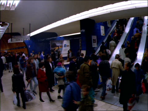 crowd in subway station as train pulls in - 1992 stock-videos und b-roll-filmmaterial