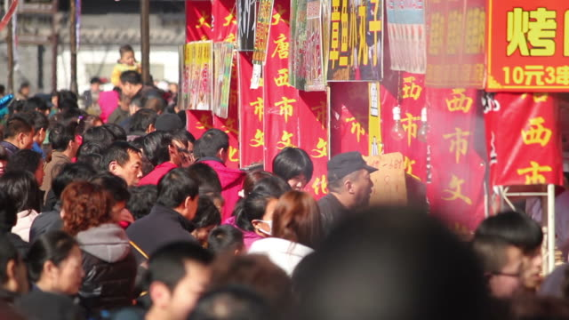 ls crowd in temple fair during the spring festival/xian,shaanxi,china - concession stand stock videos and b-roll footage