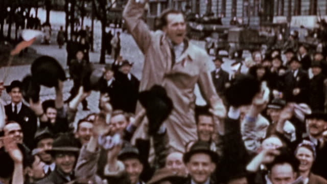 vidéos et rushes de crowd in the streets cheering waving handkerchiefs and flags and celebrating / czech republic - 1945