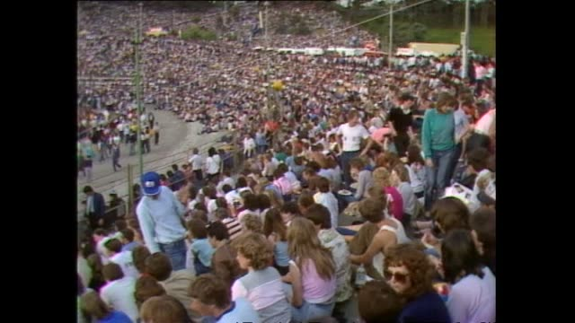 stockvideo's en b-roll-footage met crowd inside stadium prior to 1983 david bowie concert at western springs stadium in auckland - david bowie