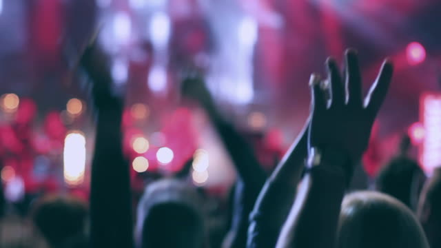 crowd jumping during a popular music concert - rock stock videos & royalty-free footage