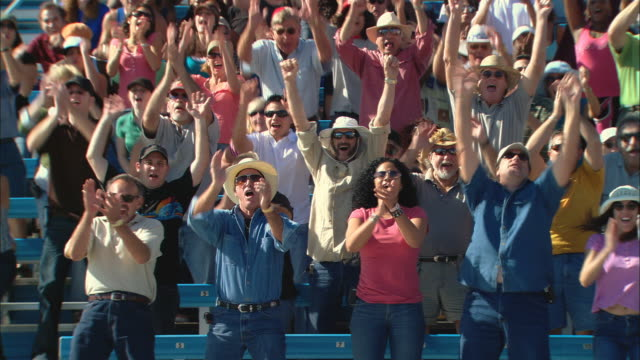 ha ws pan crowd jumping up and clapping in bleachers / homestead, fl, usa - arms raised stock videos & royalty-free footage