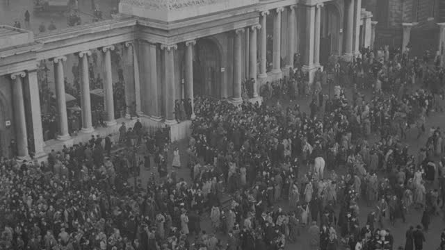 a crowd leaves hyde park following the funeral procession of king george v. - british royalty stock videos & royalty-free footage