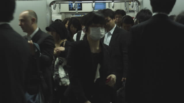 CU Crowd leaving and entering subway train on station, Tokyo, Japan