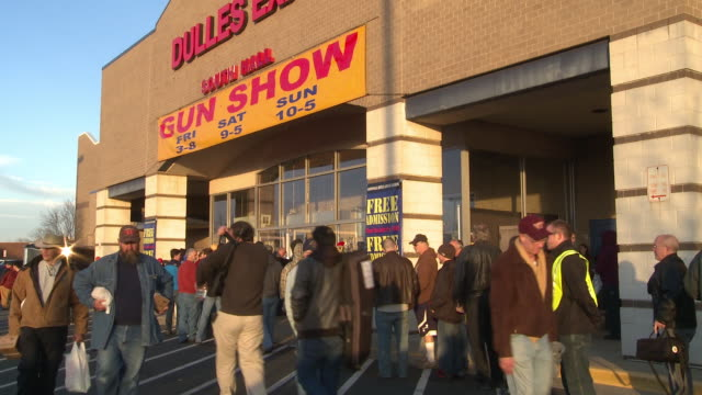 Crowd Lines Up with their Weapons at The Nation's Gun Show at the Dulles Expo Center on December 28 2012 in Dulles Virginia