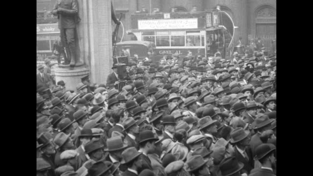 crowd listens to proclamation by king george v being read calling for new general election doubledecker bus and other traffic passes by in background - 1924 stock videos and b-roll footage