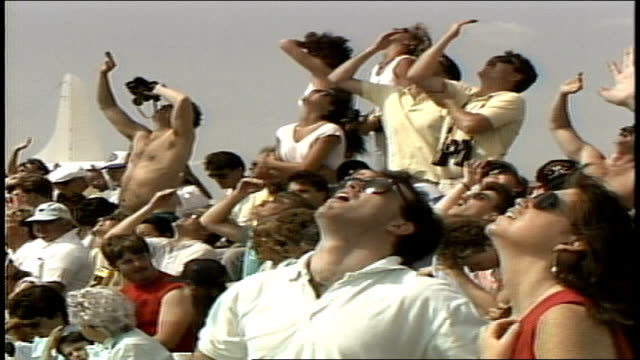 crowd looking up toward the sky at air show in portsmouth, new hampshire - airshow stock videos & royalty-free footage