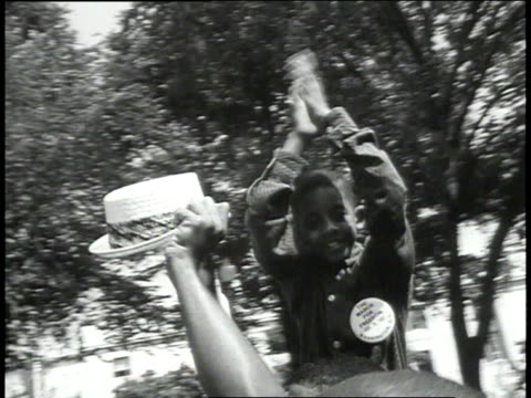 crowd marches past camera / child on shoulders clapping / marchers clasping hands / women hugging - 1963 stock videos & royalty-free footage