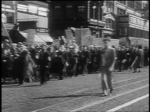 B/W 1933 crowd marching with banners at Communist demonstraton / Union Square NYC
