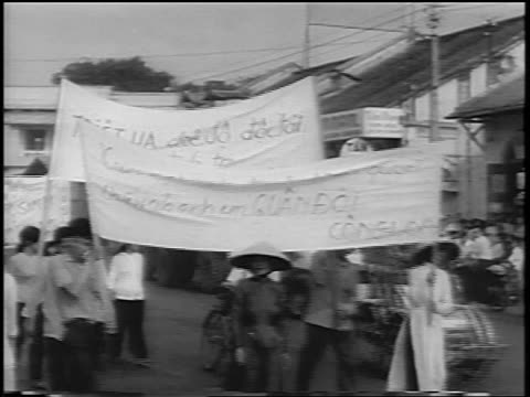 crowd marching with banners on street celebrating diem's overthrow / south vietnam / newsreel - south vietnam stock videos & royalty-free footage