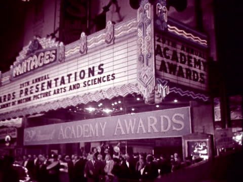 crowd milling beneath marquee outside pantages theater at night; marquee advertises the 29th annual academy awards ceremonies / large searchlights... - 1957 stock videos & royalty-free footage