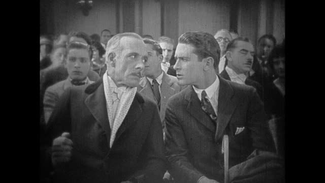 1925 crowd mocks and heckles eccentric bearded speaker at event - 1925 stock videos & royalty-free footage