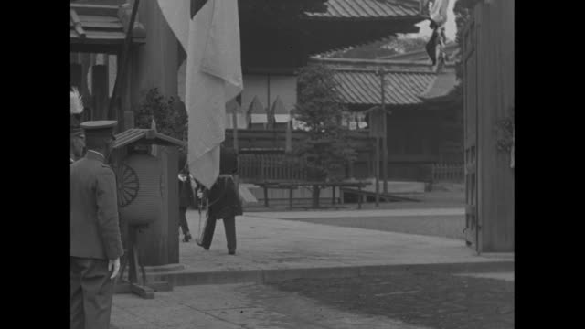 stockvideo's en b-roll-footage met crowd moves around front of imperial shrine of yasukuni / yasuhito prince chichibu dressed in military full dress uniform and carrying sword exits... - 1920 1929