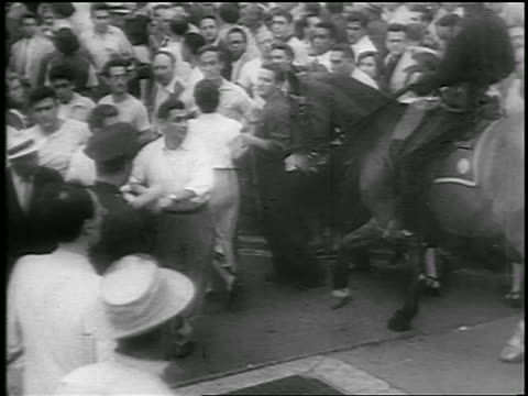 b/w 1950 crowd moves away from mounted police at communist demonstration / union square nyc - herbivorous stock videos & royalty-free footage