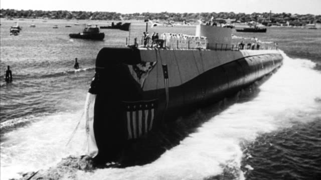 crowd of 35000 are on hand for the launching of america's eighth and largest nuclear submarine triton / louise willis wife of vice admiral john m... - groton connecticut stock videos & royalty-free footage