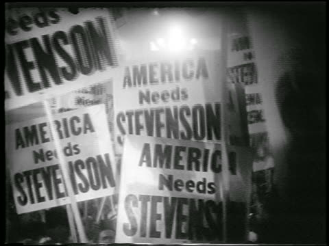"vídeos y material grabado en eventos de stock de crowd of ""american needs stevenson"" signs at democratic national convention / chicago - 1952"