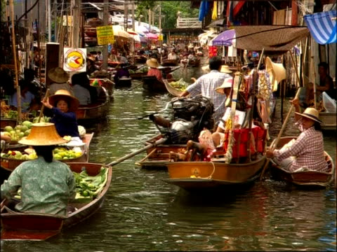 MS crowd of boats in canal at Floating Market, Bangkok, Thailand