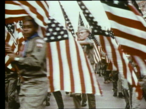 crowd of boy scouts with american flags in parade - boy scout stock videos & royalty-free footage