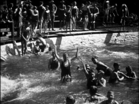 b/w 1922 crowd of boys swimming in pool at summer camp / arroyo sanitarium, livermore, california - summer camp stock videos & royalty-free footage