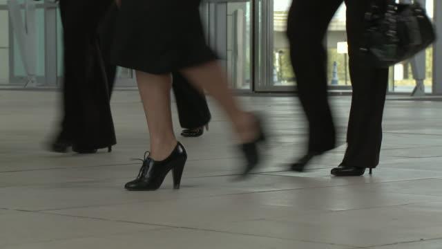 LA CU crowd of business people's feet walking in same direction