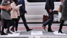 Crowd of businessmen going to work in the morning Shinjyuku Tokyo Japan
