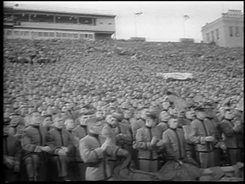 B/W 1965 crowd of cadets cheering in Army vs Navy football game / Philadelphia / newsreel