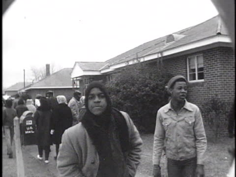 a crowd of civil rights demonstrators walk down a street in selma alabama during a voter registration march - 1965 selma marches stock videos & royalty-free footage
