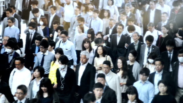 Crowd of commuters on their way to work in Tokyo