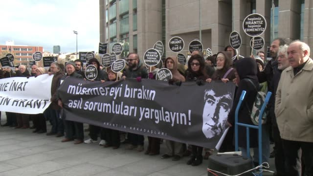 a crowd of demonstrators gathered outside an istanbul courthouse tuesday to demand justice over the 2007 murder of ethnic armenian journalist hrant... - killing stock videos & royalty-free footage