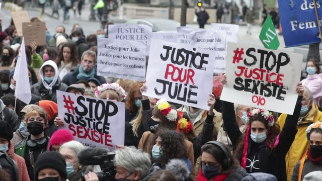"crowd of demonstrators hold banner on the place st michel during a demonstration of feminist collectives to demand ""justice for julie"" on february 7,... - partisan politics stock videos & royalty-free footage"