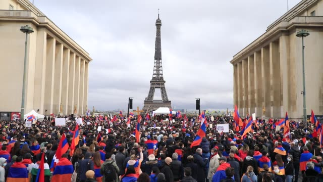 crowd of demonstrators in trocadero square moves in front of the eiffel tower in the background during a demonstration organized by the cooperation... - symbols of peace stock videos & royalty-free footage