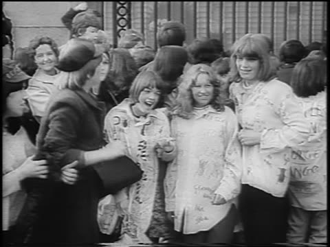 b/w 1965 crowd of excited teen girls outside of buckingham palace waiting for beatles / london - teenagers only stock videos & royalty-free footage