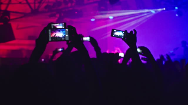 crowd of fans filming music concert - concerto video stock e b–roll